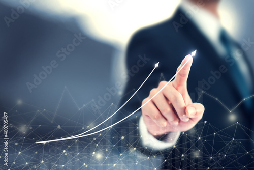 Development and growth concept. Businessman plan graph stock of growth and increase of positive indicators in his business 2021. - fototapety na wymiar