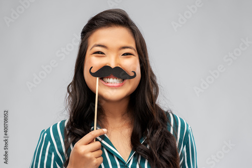 Obraz na plátně party props, photo booth and people concept - happy asian young woman with big b