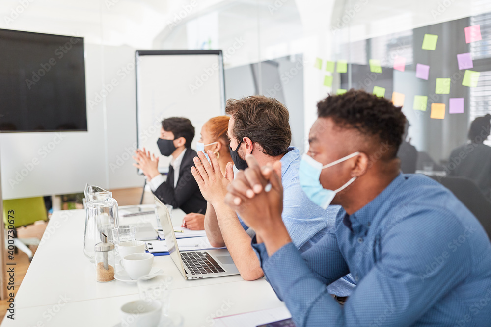 Fototapeta Business people in conference room with mask