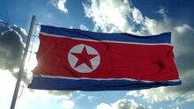 North Korea Flag Waving In The Wind Against Deep Blue Sky. National Theme, International Concept. 3d Rendering