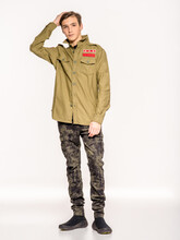 Young Man In Camouflage Clothing. Rookie In Army Clothes. Teenager In Khaki Military Clothing.