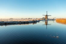 Windmill 't Hoog- En Groenland With A Refection In The Angstel River In The Village Baambrugge In The Netherlands.