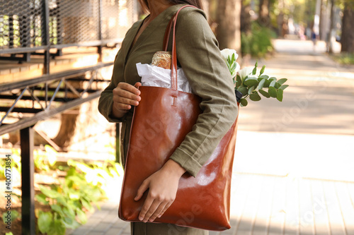 Obraz Woman with leather shopper bag on city street, closeup - fototapety do salonu