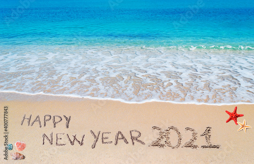 Fototapeta happy new year 2021 on the beach obraz