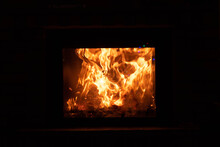 Wooden Eagle Bird Burning In The Fireplace - Phoenix Metaphor, Fire And Renewal