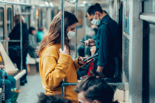Fotografie, Tablou variety of passengers ride the subway car