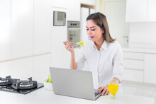 Young Woman Eating Salad During Work From Home