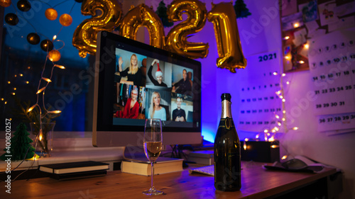 Fototapeta Celebrating Virtual Christmas New Year's Eve party 2021 at home during Covid-19 pandemic