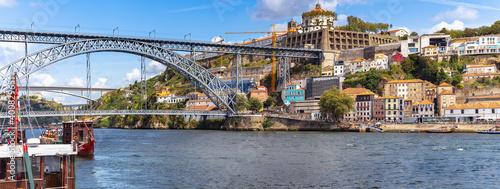 Obraz People enjoy the sunny and warm on the riverside quay of Porto. Portugal - fototapety do salonu