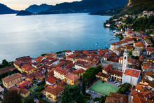 Italy, Province Of Como, Menaggio, Helicopter View Of Town On Shore Of Lake Como At Dawn