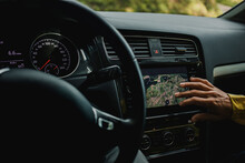 Hand Of Woman Checking Digital Maps In Car During Vacations