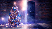 New Year Tree With Toys In The Interior, Open Doors, Magic Light, Old Brick Wall. Festive Fabulous Interior With Garlands And Lights. Background For Postcards.