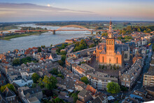 Netherlands, Gelderland, Nijmegen, Aerial View Of Saint Stephens Church And Surrounding Buildings At Dusk