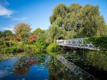 Denmark, Copenhagen, Bridge Over Botanical Garden Pond In Nyhavn