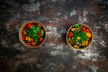 Two Bowls Of Grilled Eggplants And Bell Peppers With Parsley