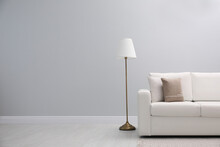 Simple Room Interior With Comfortable White Sofa, Space For Text