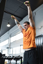 Male Athlete Doing Suspension Training In Gym