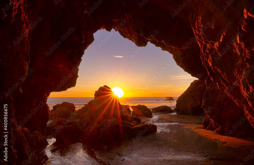 Fototapeta Sunstar along the pacific at sunset