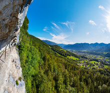 Austria, Upper Austria, Bad Goisern Am Hallstattersee, Steep Mountainside Trail Of Eternal Wall With Town In Background