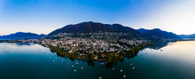 Switzerland, Canton Of Ticino, Locarno, Helicopter View Of Town On Shore Of Lake Maggiore At Dawn