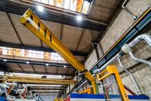 Industrial Crane In Illuminated Factory