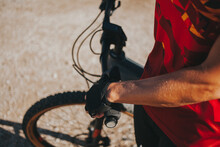 Hand Of Female Cyclist Holding Bicycle Handle On Sunny Day, Picos De Europa National Park, Cantabria, Spain
