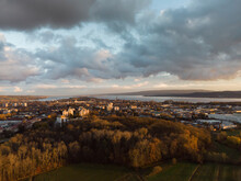 Germany, Baden-Wurttemberg, Radolfzell, Gray Clouds Over Lakeshore Town In Autumn