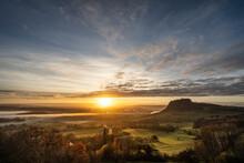 Germany, Baden-Wurttemberg, Singen, Foggy Sunrise WithÔøΩHohentwiel Mountain In Background