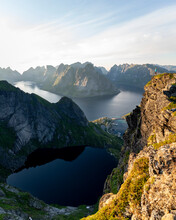 Female Hiker Admiring View While Standing On Mountain At Reinebringen, Lofoten, Norway