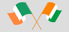 Crossed And Waving Flags Of Ireland And Republic Of Ivory Coast