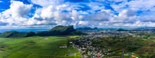 Mauritius, Black River, Flic-en-Flac, Helicopter View Of Island City With Corps De Garde Mountain In Background