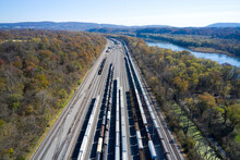 Aerial View Of Railroad Cars Waiting On Tracks Stretching Along Chesapeake And Ohio Canal