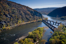USA, West Virginia, Harpers Ferry, Aerial View Of Twin Bridges Over Confluence Of Potomac And Shenandoah Rivers