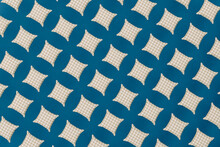 Pattern Of White Checked Cushions Against Blue Background
