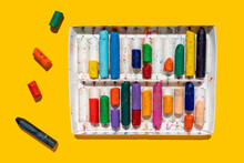 Colorful Crayons On Yellow Background
