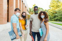 University Students Wearing Protective Face Mask While Standing In Campus