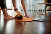 Middle Aged Yogi Woman Doing Yoga At Home.