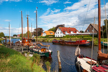 Germany, Lower Saxony,ÔøΩWittmund,ÔøΩSailboats Moored Along Bank Of Harle River