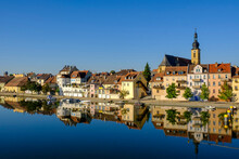 Germany, Bavaria, Kitzingen, Town Buildings Witch Church Seen Across Main River