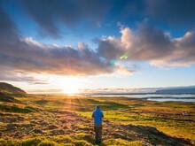Male Hiker Admiring Sunset Over Snaefellsnes Peninsula, Iceland