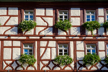 Germany, Bavaria, Volkach, Half-timbered Cloth House, Windows With Flowers