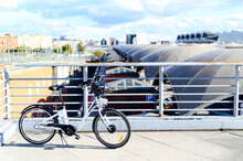 Electric Bicycle Parked On Bridge During Sunny Day