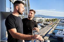 Gay Couple On Footbridge While Mediterranean Sea In Background