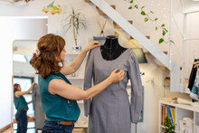 Female Design Professional Dressing Mannequin With Gray Dress At Atelier
