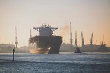 Germany, Hamburg, Ship Leaving Harbor At Dusk