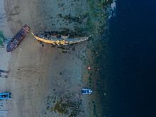 Aerial View Of Old Boats Abandoned On Coastal Beach OfBarents Sea
