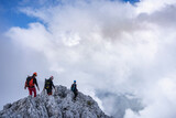 Mature men hiking on mountain against cloudy sky, Bergamasque Alps, Germany