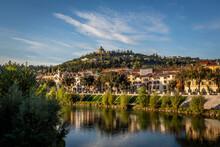 Italy, Veneto, Verona, City Houses Along Adige River In Summer