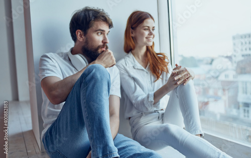 Fotomural Young family near window rest hugs interior lifestyle
