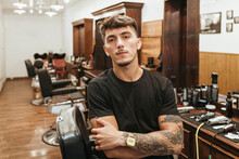 Trendy Hairdresser Standing Arms Crossed At Salon